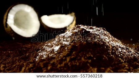 Super slow motion of coconut on cacao macro (close up) stock photo