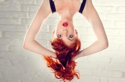 Surprised green-eyed girl upside down