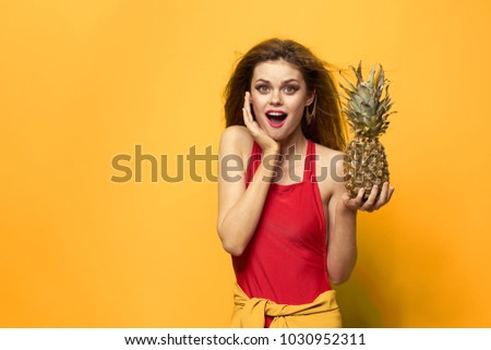 surprised woman with pineapple on yellow background                               #1030952311