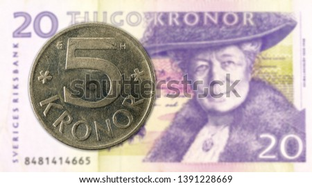 5 swedish krona coin against 20 swedish krona bank note #1391228669