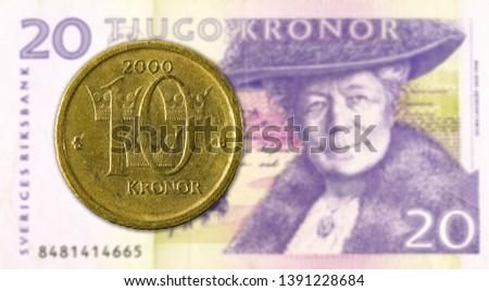 10 swedish krona coin against 20 swedish krona bank note #1391228684