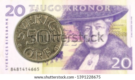 50 swedish oere coin against 20 swedish krona bank note #1391228675