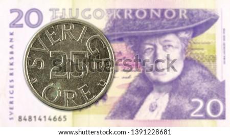 25 swedish oere coin against 20 swedish krona bank note #1391228681
