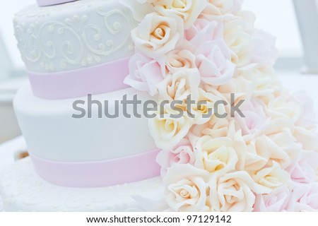 Sweet wedding Cake. Background pink with white flowers
