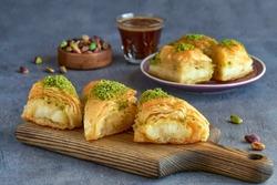 Sweets arabic dessert kunefe, kunafa, kadayif with pistachio and cheese