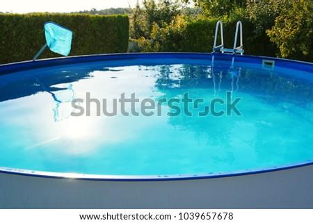 swimming portable pool in garden #1039657678