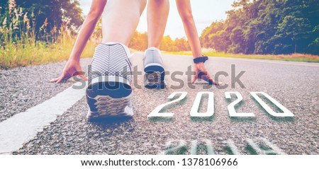 2020  symbolises number the Athletic starting to change new year, Start of people running on a street road with sunset light.Goal of Success the winner