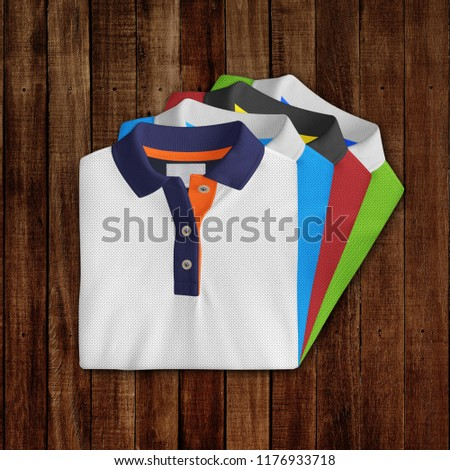 T-Shirt mockup, folded and stacked front view on wooden background