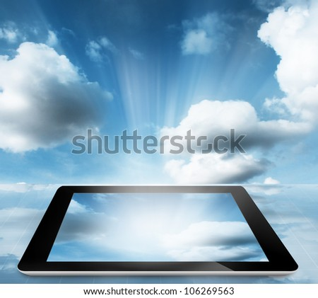 tablet pc computer with cloud sky