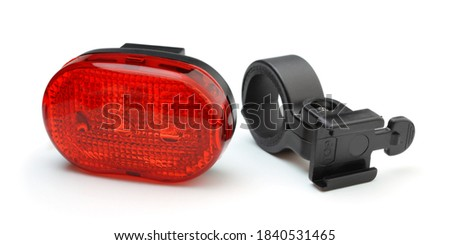 Photo of   Tail plastic bicycle light isolated on white.