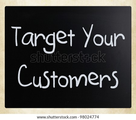 """Target your customers"" handwritten with white chalk on a blackboard"