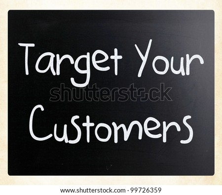 """""""Target your customers"""" handwritten with white chalk on a blackboard"""