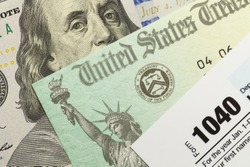 1040 Tax Form with Refund Check and Cash.