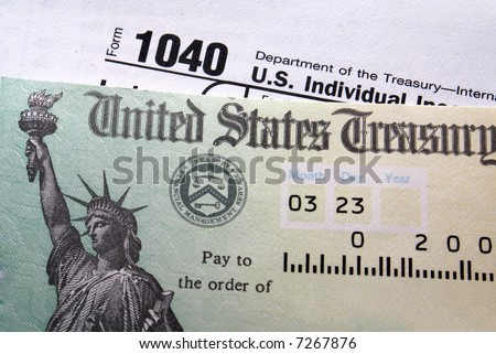 Tax return check on 1040 form background - stock photo