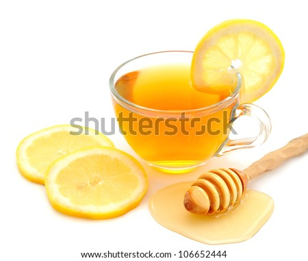 Tea with lemon and honey on a white background