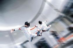 Team building fly men. Air skydiving team of flying people in wind tunnel . indoor skydiving