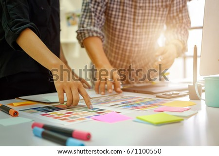 Team of Designers working at office. Designers Brainstorming. - Shutterstock ID 671100550