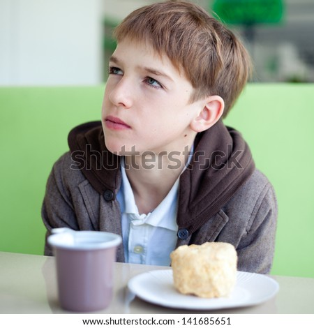 teenager in cafe eating fast food, indoor