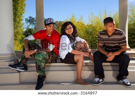 3 teens looking right - stock photo