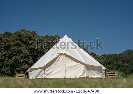 Tent, tent behind, mountain and blue sky. #1268647438