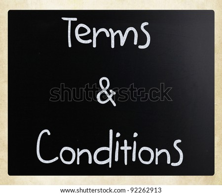 """Terms & Conditions"" handwritten with white chalk on a blackboard"