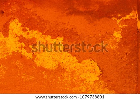 \nterracotta texture, orange bright wall with cracks
