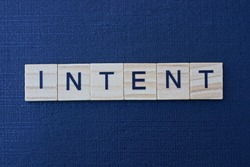 text on word intent from gray wooden letters on a black background