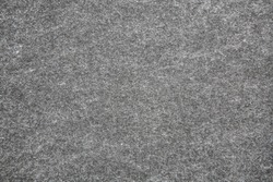 Texture of gray felt fabric. Grunge background.