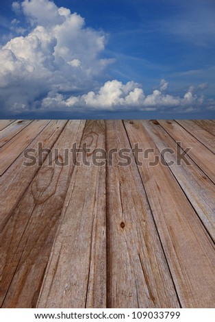 texture of wood terrace perspective to blue sky white clouds