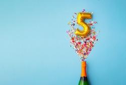5th anniversary champagne bottle balloon pop