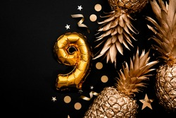 9th birthday celebration background with gold balloons and golden pineapples