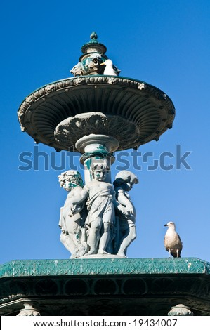 18th bronze fountain in Rossio Square, Lisbon, Portugal.