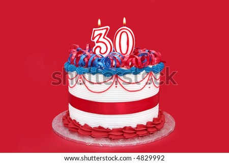 30th cake with numeral candles, on vibrant red background.