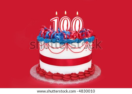 100th cake with numeral candles, on vibrant red background