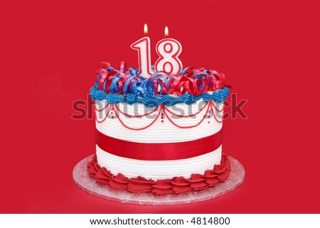 18th cake, with numeral candles, on vibrant red background.  A special birthday.