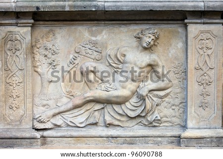18th century bas-relief of the Apollo (God in Greek mythology) by Johann Heinrich Meissner on the historic tenement house terrace in the Old Town of Gdansk, Poland