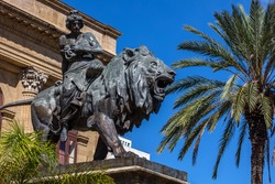 19th century bronze statue representing the Lyric seated on a lion by Sir Mario Rutelli, located next to the Massimo Theater's entrance staircase in Palermo, Sicily.