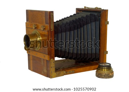 19th century folding photo camera, with bellows for focusing, isolated