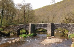 17th Century Packhorse Stone Fingle Bridge on the River Teign near Drewsteighton within Dartmoor National Park in Devon, England, UK