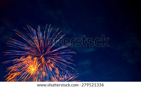 4th July fireworks. Fireworks display on dark sky background. #279521336