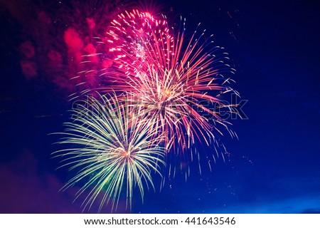 4th July fireworks. Fireworks display on dark sky background. #441643546