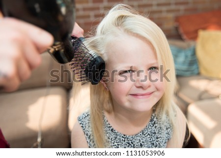 10th - July - 2018 - Staffordshire - Beautiful little smiling blonde girl having her hair styled by a mobile hairdresser #1131053906