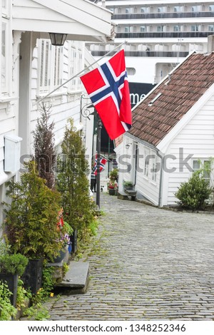 17th May Norway celebrates its constitution day. Is is a very happy day when national flags are waved and parades take place. Here a quiet corner of gamle Stavanger (cruise ship in the background) #1348252346