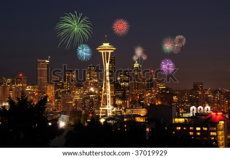 4th of July celebrations and fireworks over Seattle downtown skyline