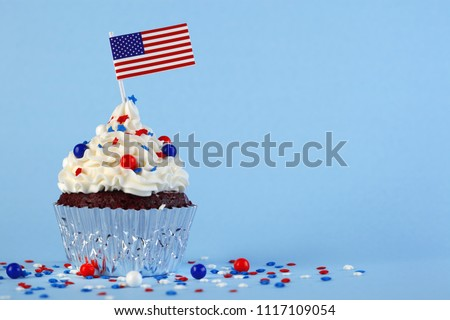 4th of July cupcake with flag and sprinkles