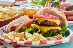 4th of july themed burger and hot dog meal on paper plate