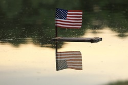 4th of July, US Independence Day, USA flag, wooden raft on the water