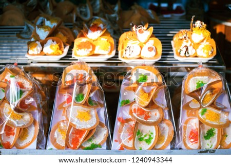 Thai desserts,Thai street food ,Thai food on the streets in Bangkok in the evening people come to buy food. And tourists to walk. A delicious source of delicious food in Thailand. #1240943344