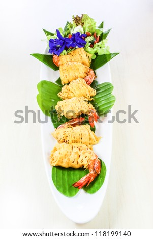 """Thai food called """"Shrimp rhoom"""" or """"Shrimp La-tiang"""" ; (Minced Shrimp wrapped in Egg-net). It is rarely food but well-known for Phuket, Thailand"""