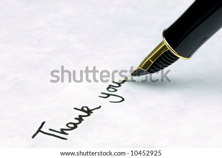 'Thank You' written on watermarked textured paper using a gold nibbed fountain pen. Focal point is on the text.